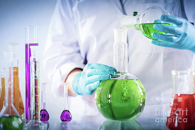 Photograph - Laboratory Worker Mixes Chemical Liquid Sample. by Michal Bednarek