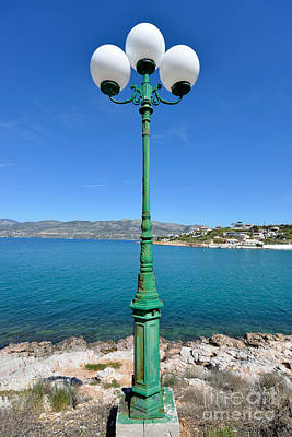 Photograph - Lamp Post By The Seaside by George Atsametakis
