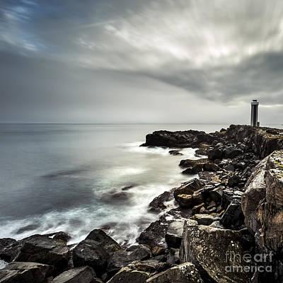 Photograph - Lighthouse By The Sea by Gunnar Orn Arnason