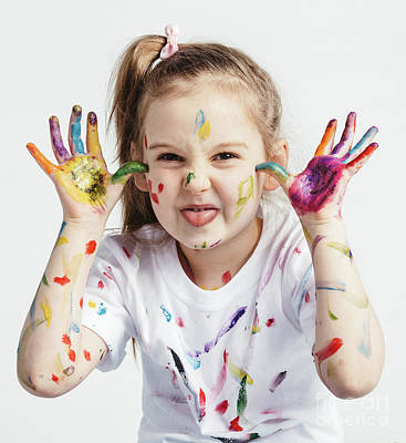 Photograph - Little Girl Covered In Paint Making Funny Faces. by Michal Bednarek