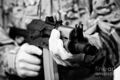 Man In Combat Fatigues Holding Aks-47u Close Quarter Combat Kalashnikov Rifle Art Print