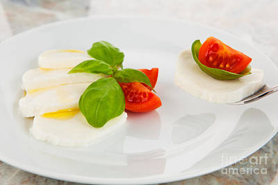 Herbs Photograph - Mozzarella Salad With Tomatoes And Basil On A Fork by Wolfgang Steiner