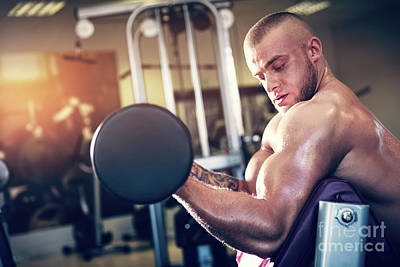 Photograph - Muscular Man Working Out At A Gym. by Michal Bednarek