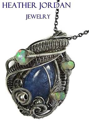 Sterling Silver Jewelry - Natural Tanzanite Wire-wrapped Pendant In Antiqued Sterling Silver With Ethiopian Welo Opals by Heather Jordan