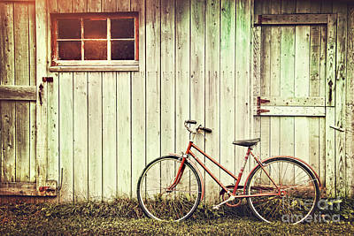 Old Bicycle Leaning Against Grungy Barn Art Print