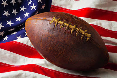 Weatherworn Photograph - Old Football On American Flag by Garry Gay
