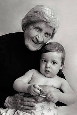 Rusty Trucks - Old Gray-haired Grandmother Sits With A Small Grandson by Elena Saulich