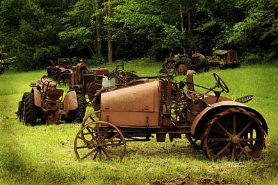 Photograph - Old Tractor Graveyard by James C Thomas