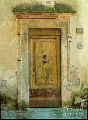 Queen Rights Managed Images - Old Tuscan Door Royalty-Free Image by Norma Brandsberg
