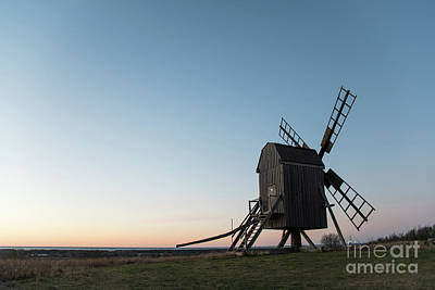 Photograph - Old Wooden Windmill By Evening Light by Kennerth and Birgitta Kullman