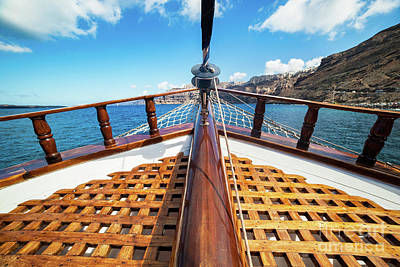 Moving Photograph - On Board View From A Traditional Ship Cruising On Aegean Sea Next To Santorini Island by Michal Bednarek
