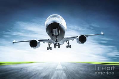 Photograph - Passenger Airplane Taking Off On Runway by Michal Bednarek
