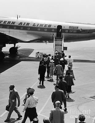 Passengers Boarding A Plane Art Print