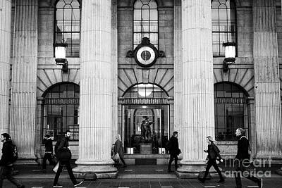 Postoffice Photograph - people walking past the clock and cuchullain statue in the window of the gpo Dublin Republic of Irel by Joe Fox