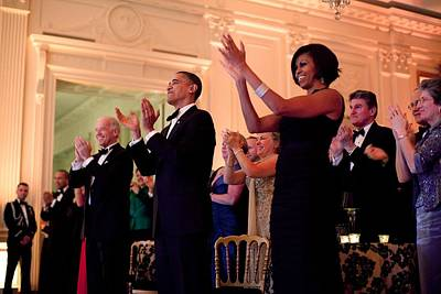 Biden Photograph - President And Michelle Obama Applaud by Everett