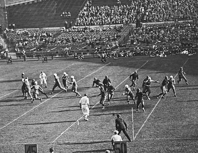 Photograph - Quarterback Throwing Football by Underwood Archives