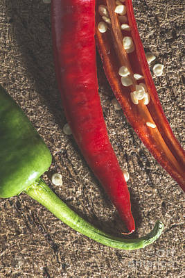 Photograph - Red Hot Peppers On Wooden  Cutting Board by Deyan Georgiev