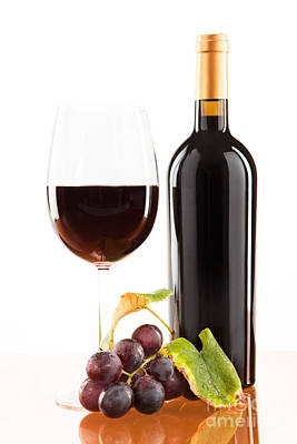Red Wine In Glass With Bottle And Wine Grapes Art Print by Wolfgang Steiner