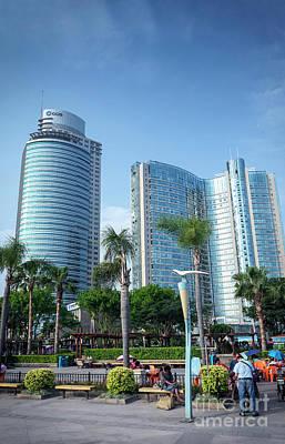 Photograph - Riverside Promenade Park And Skyscrapers In Downtown Xiamen City by Jacek Malipan