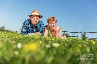 Photograph - Senior Couple Lying On The Summer Field In Green Grass by Michal Bednarek