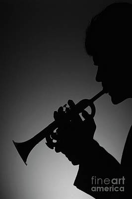 Photograph - Silhouetted Man Playing Trumpet by Jim Corwin