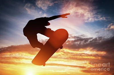 Photograph - Skateboarder Jumping At Sunset. by Michal Bednarek