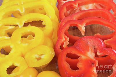Photograph - Sliced Raw Red And Yellow Bell Peppers by Vizual Studio