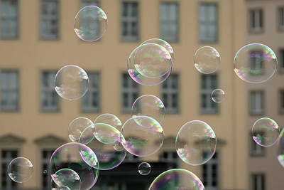 Vintage Pharmacy - Soap bubbles in front of an old house by Stefan Rotter