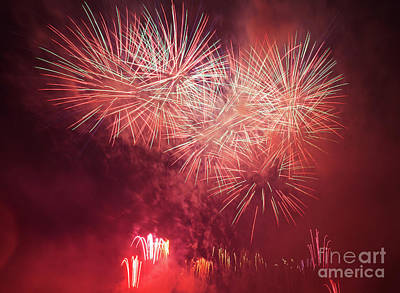 Celebrate Photograph - Spectacular Fireworks Show Light Up The Sky. New Year Celebration. by Michal Bednarek