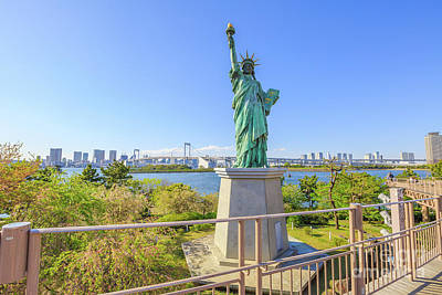 Photograph - Statue Of Liberty And Rainbow Bridge by Benny Marty