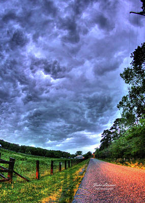 Photograph - Storm Clouds Over Main Street by John Loreaux