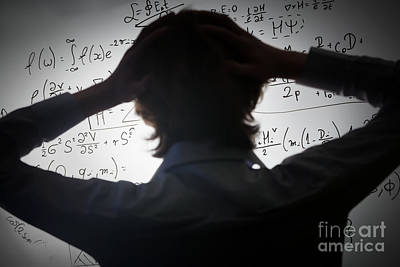 Whiteboard Photograph - Student Holding His Head Looking At Complex Math Formulas On Whiteboard by Michal Bednarek
