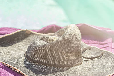 Photograph - Sun Hat Lying On A Towel Near The Pool by Patricia Hofmeester