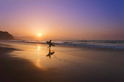 Surfer Entering Water At Sunset Art Print by Mikel Martinez de Osaba