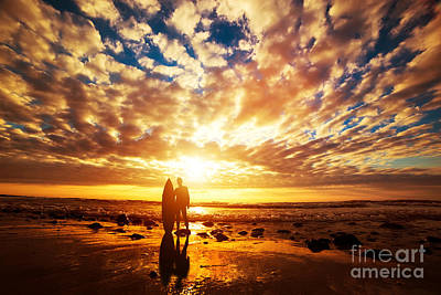Surfer Standing With His Surfboard On The Beach At Sunset Over The Ocean Art Print by Michal Bednarek
