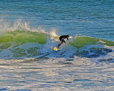 Photograph - Surfing At Cannon Beach by Jack Moskovita