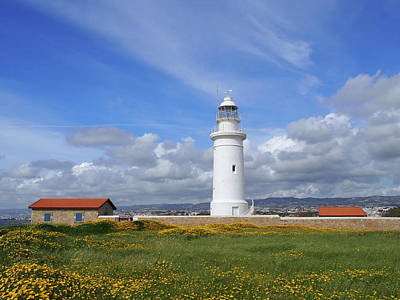 Photograph - The Old Lighthouse In Paphos Cyprus Surrounded By Historic Buildings With Spring Flowers Growing Alongside A Path Leading To The Sea With Bright Blue Sky And White Clouds by Philip Openshaw