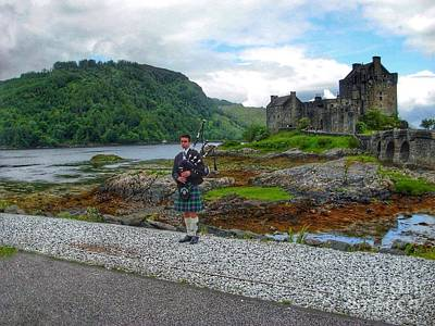 Photograph - The Piper At Eilean Donan Castle 2 by Joan-Violet Stretch