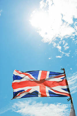 Photograph - The Union Jack, The National Flag Of The United Kingdom Waving On Wind by Michal Bednarek