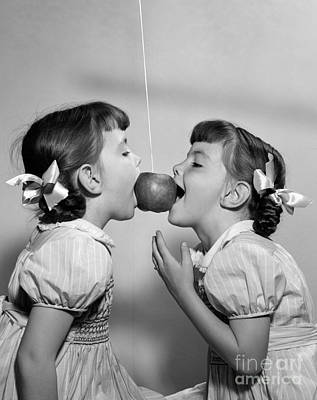 Twin Girls Bobbing For Apple Art Print by H. Armstrong Roberts/ClassicStock