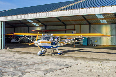 Photograph - Ultralight Plane In Hangar by Patricia Hofmeester