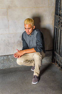 Photograph - Unhappy Young Hispanic American Man Squatting At Corner, Thinkin by Alexander Image