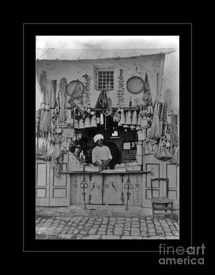 Photograph - Vendor In Vaulted Bazaar Tunisia by John Stephens
