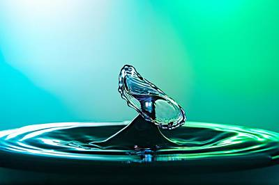 Photograph - Water Drop Collision Close Up Image With A Green And Blue Background by Teemu Tretjakov