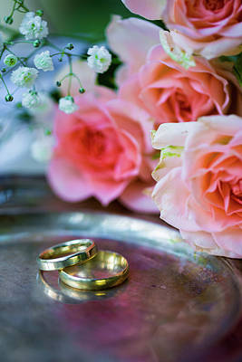 Floral Engagement Ring Photograph - Wedding Rings Before The Ceremony, With Decorated Champagne Glasses And Roses by Chinara Rasulova