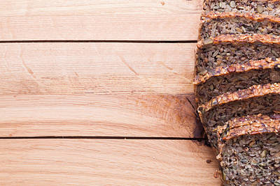 Snacks Photograph - Wholemeal Bread On Wooden Table by Michal Bednarek