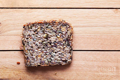 Table Photograph - Wholemeal Slice Of Bread On Wooden Table by Michal Bednarek