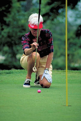 Photograph - Woman Golfer Calculates Putt by Carl Purcell