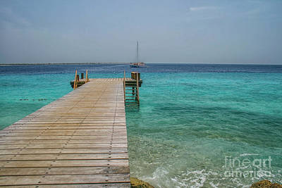 Photograph - Wooden Jetty And Boat by Patricia Hofmeester