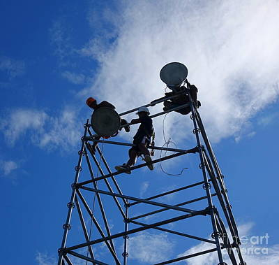 Photograph - Workers Set Up Powerful Floodlights by Yali Shi